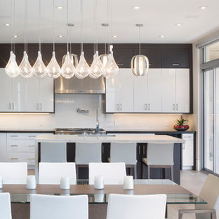 Inspiration for a large modern l-shaped eat-in kitchen in Toronto with a double-bowl sink, flat-panel cabinets, white cabinets, marble benchtops, white splashback, slate splashback, stainless steel appliances, light hardwood floors, with island and yellow floor.