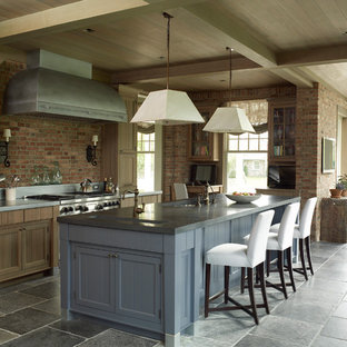 Large farmhouse eat-in kitchen remodeling - Inspiration for a large farmhouse galley gray floor eat-in kitchen remodel in San Francisco with brick backsplash, stainless steel appliances, an island, an undermount sink, shaker cabinets, medium tone wood cabinets, red backsplash and gray countertops