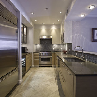 Inspiration for a contemporary u-shaped kitchen remodel in New York with stainless steel appliances, a single-bowl sink, flat-panel cabinets, medium tone wood cabinets, blue backsplash and mosaic tile backsplash