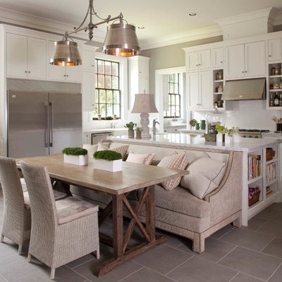 Large elegant u-shaped porcelain tile and gray floor kitchen photo in Houston with stainless steel appliances, an undermount sink, shaker cabinets, white cabinets, granite countertops, white backsplash, subway tile backsplash and an island