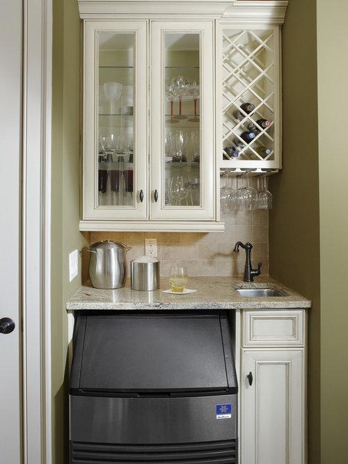 traditional kitchen idea in atlanta with glassfront cabinets beige cabinets and beige backsplash