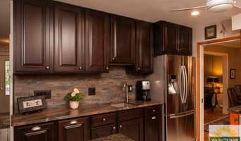 Holiday Kitchens Cherry Cabinets, Copper Dune Quartzite counters, stacked stone
