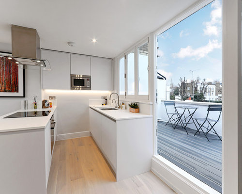 Small Contemporary Galley Kitchen In London With A Submerged Sink,  Flat Panel Cabinets,