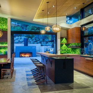 Contemporary kitchen designs - Inspiration for a contemporary galley concrete floor kitchen remodel in San Diego with flat-panel cabinets, medium tone wood cabinets and an island