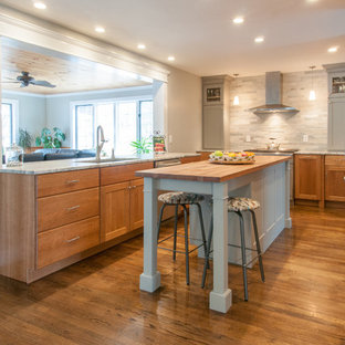 Large transitional u-shaped kitchen pantry in Boston with an undermount sink, light wood cabinets, granite benchtops, stainless steel appliances, medium hardwood floors, with island, multi-coloured floor, flat-panel cabinets, green splashback and stone tile splashback.