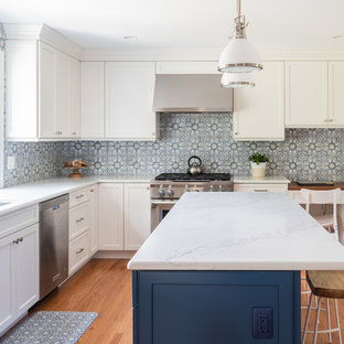Mid-sized transitional eat-in kitchen designs - Mid-sized transitional l-shaped medium tone wood floor and brown floor eat-in kitchen photo in Philadelphia with an undermount sink, recessed-panel cabinets, white cabinets, quartzite countertops, multicolored backsplash, ceramic backsplash, stainless steel appliances, an island and white countertops