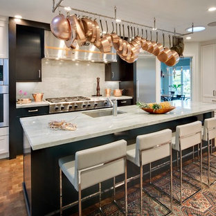 Large transitional enclosed kitchen remodeling - Example of a large transitional l-shaped medium tone wood floor enclosed kitchen design in Los Angeles with an undermount sink, white cabinets, quartzite countertops, gray backsplash, stone slab backsplash, stainless steel appliances, an island and shaker cabinets