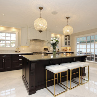 Inspiration for a large traditional eat-in kitchen in Toronto with an undermount sink, brown cabinets, quartz benchtops, beige splashback, glass tile splashback, panelled appliances, marble floors, with island, grey floor and green benchtop.