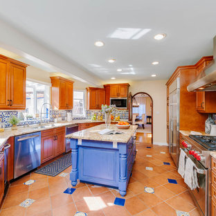 Large mediterranean eat-in kitchen designs - Inspiration for a large mediterranean u-shaped multicolored floor eat-in kitchen remodel in Los Angeles with raised-panel cabinets, granite countertops, multicolored backsplash, mosaic tile backsplash, stainless steel appliances, an island, medium tone wood cabinets and a double-bowl sink