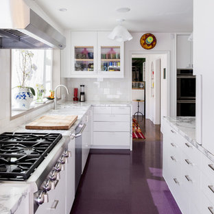 Inspiration for a large transitional l-shaped kitchen in Los Angeles with glass-front cabinets, white cabinets, marble benchtops, stainless steel appliances, no island and purple floor.