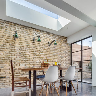 Photo of a medium sized contemporary l-shaped kitchen in London with concrete flooring.