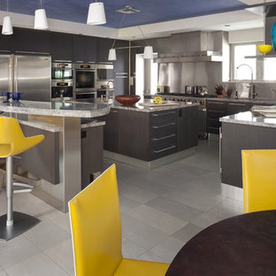 Example Of A Trendy Kitchen Design In Miami With Granite Countertops And  Stainless Steel Appliances