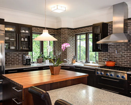 Example Of An Eclectic Kitchen Design In Detroit With Stainless Steel Appliances Wood Countertops