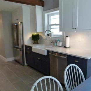Inspiration for a medium sized farmhouse galley kitchen/diner in New York with a belfast sink, shaker cabinets, white cabinets, composite countertops, white splashback, terracotta splashback, stainless steel appliances, concrete flooring, no island, grey floors and white worktops.