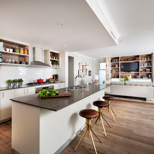 Inspiration for a large transitional open concept kitchen remodel in Perth with a double-bowl sink, flat-panel cabinets, white cabinets, white backsplash, subway tile backsplash and an island