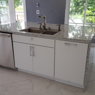 Photo of a large modern single-wall eat-in kitchen in Minneapolis with flat-panel cabinets, white cabinets, white splashback, stainless steel appliances, with island, a double-bowl sink, terrazzo benchtops, porcelain floors and white floor.