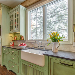 Traditional kitchen appliance - Example of a classic kitchen design in St Louis with white appliances, green cabinets and travertine backsplash