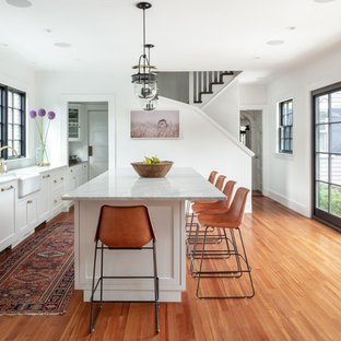 Example Of A Farmhouse Medium Tone Wood Floor Kitchen Design In Boston With  An Island,