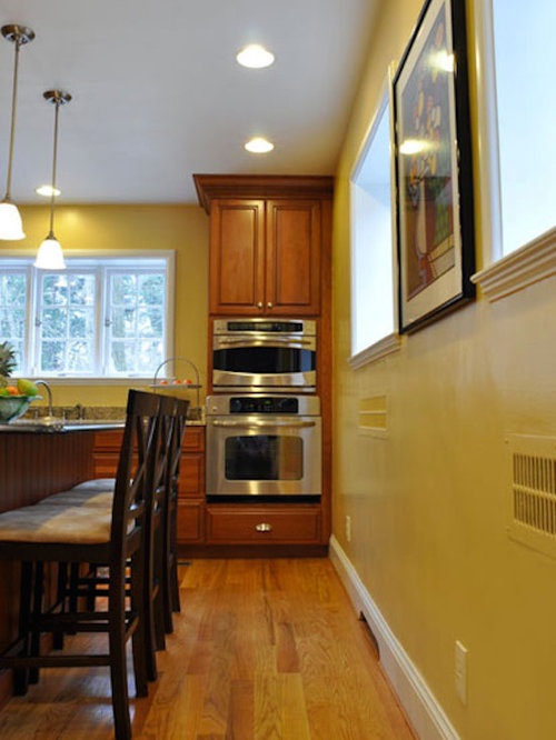 27 Yellow Kitchen Pantry with Medium Tone Wood Cabinets Design Ideas & Remodel Pictures | Houzz