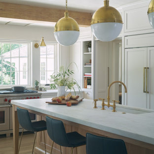 Transitional kitchen photos - Kitchen - transitional medium tone wood floor and brown floor kitchen idea in Birmingham with recessed-panel cabinets, white cabinets, marble countertops, white appliances, an island, white countertops and an undermount sink