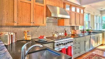 Honed, absolute-black granite countertops and prep sink