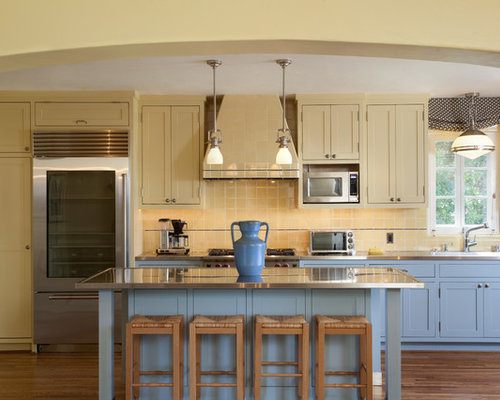 Example Of A Tuscan Dark Wood Floor Kitchen Design In Santa Barbara With Shaker Cabinets