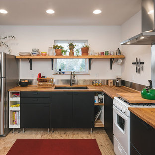 Inspiration for a contemporary l-shaped kitchen in Portland with wood benchtops, metallic splashback, plywood floors, a double-bowl sink, brown floor and brown benchtop.