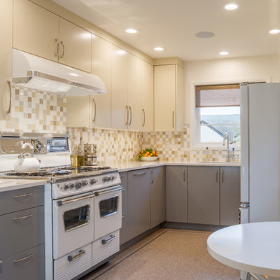 Inspiration for a mid-sized 1950s u-shaped linoleum floor eat-in kitchen remodel in Portland with an undermount sink, flat-panel cabinets, multicolored backsplash, ceramic backsplash, white appliances, no island, quartz countertops and gray cabinets