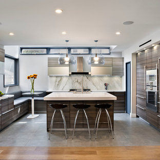 Example of a mid-sized trendy l-shaped eat-in kitchen design in New York with an undermount sink, flat-panel cabinets, dark wood cabinets, white backsplash, stainless steel appliances, an island, quartz countertops and marble backsplash