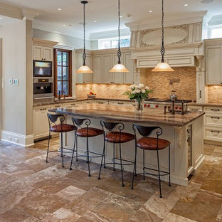 Elegant u-shaped kitchen photo in Toronto with recessed-panel cabinets, beige cabinets, beige backsplash and stainless steel appliances