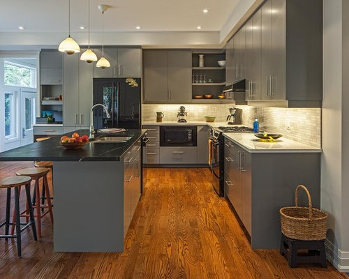 Trendy Kitchen Photo In Toronto With A Double Bowl Sink, Flat Panel Cabinets