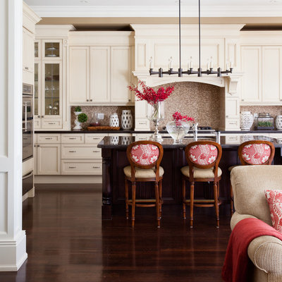 Elegant brown floor open concept kitchen photo in Toronto with stainless steel appliances, recessed-panel cabinets, beige cabinets, brown backsplash, mosaic tile backsplash and brown countertops