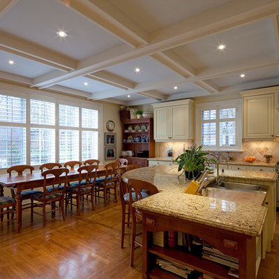 Example of a classic eat-in kitchen design in Toronto with stainless steel appliances and beige backsplash