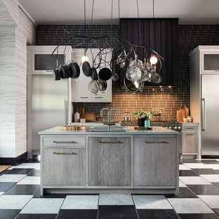 Trendy galley eat-in kitchen photo in San Francisco with gray backsplash, brick backsplash, two islands, an undermount sink, flat-panel cabinets and stainless steel appliances