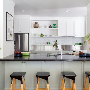 Inspiration for a transitional u-shaped kitchen in Perth with shaker cabinets, stainless steel benchtops, an undermount sink, grey cabinets, grey splashback, stainless steel appliances, no island and black benchtop.