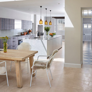 Contemporary eat-in kitchen ideas - Example of a trendy galley limestone floor eat-in kitchen design in Devon with a single-bowl sink, flat-panel cabinets, gray cabinets, marble countertops, an island, gray backsplash, glass sheet backsplash and stainless steel appliances