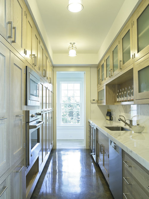 Example Of A Country Galley Enclosed Kitchen Design In New York With  Stainless Steel Appliances