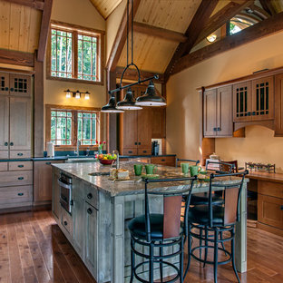 Large craftsman open concept kitchen designs - Open concept kitchen - large craftsman u-shaped medium tone wood floor open concept kitchen idea in Nashville with a farmhouse sink, shaker cabinets, medium tone wood cabinets, granite countertops, stainless steel appliances and an island