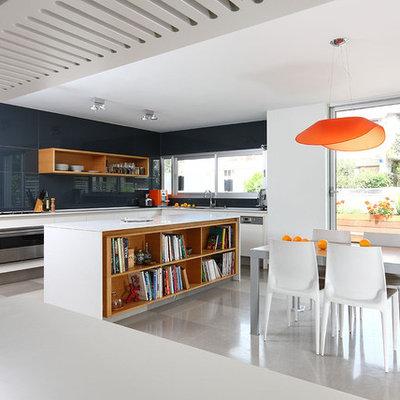 Eat-in kitchen - small modern l-shaped limestone floor eat-in kitchen idea in Tel Aviv with open cabinets, white cabinets, blue backsplash, glass sheet backsplash, stainless steel appliances, a drop-in sink, quartz countertops and an island