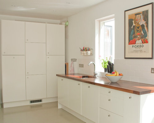Ordinaire Inspiration For A Contemporary Beige Floor Kitchen Remodel In Other With  Wood Countertops, Flat
