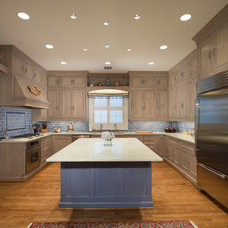Rustic Kitchen by Cabinets & Designs