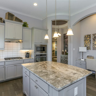 Design ideas for a mid-sized l-shaped eat-in kitchen in Houston with a double-bowl sink, recessed-panel cabinets, grey cabinets, granite benchtops, white splashback, subway tile splashback, stainless steel appliances, dark hardwood floors, with island and purple floor.