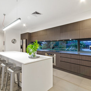 Design ideas for a contemporary galley kitchen in Perth with flat-panel cabinets, dark wood cabinets, window splashback, with island and grey floor.