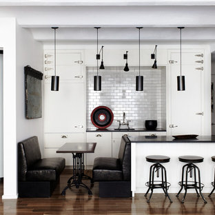 Contemporary open concept kitchen ideas - Open concept kitchen - contemporary open concept kitchen idea in New York with subway tile backsplash, flat-panel cabinets, white cabinets and white backsplash