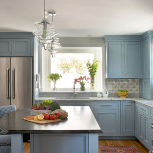 This is an example of a mid-sized traditional l-shaped kitchen in Boston with an undermount sink, beaded inset cabinets, blue cabinets, quartz benchtops, blue splashback, ceramic splashback, stainless steel appliances, with island, brown floor, grey benchtop and medium hardwood floors.
