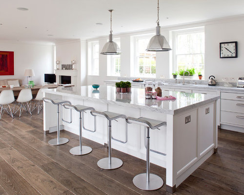 traditional eatin kitchen idea in wiltshire with flatpanel cabinets white cabinets