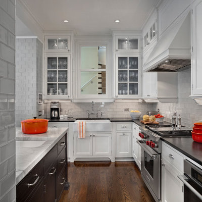 Inspiration for a transitional kitchen remodel in Chicago with a farmhouse sink, quartzite countertops, gray backsplash, glass tile backsplash and stainless steel appliances