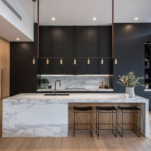 Design ideas for a contemporary kitchen in Adelaide with a double-bowl sink, flat-panel cabinets, black cabinets, marble benchtops, white splashback, marble splashback, panelled appliances, light hardwood floors, with island, beige floor and white benchtop.