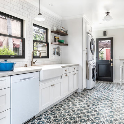 Inspiration for a mid-sized country galley cement tile floor and multicolored floor enclosed kitchen remodel in Los Angeles with white cabinets, marble countertops, white backsplash, ceramic backsplash, white appliances, no island, a farmhouse sink and shaker cabinets
