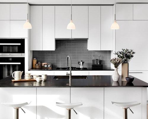 modern kitchen appliance minimalist light wood floor kitchen photo in dc metro with an undermount - White Kitchen Black Countertop